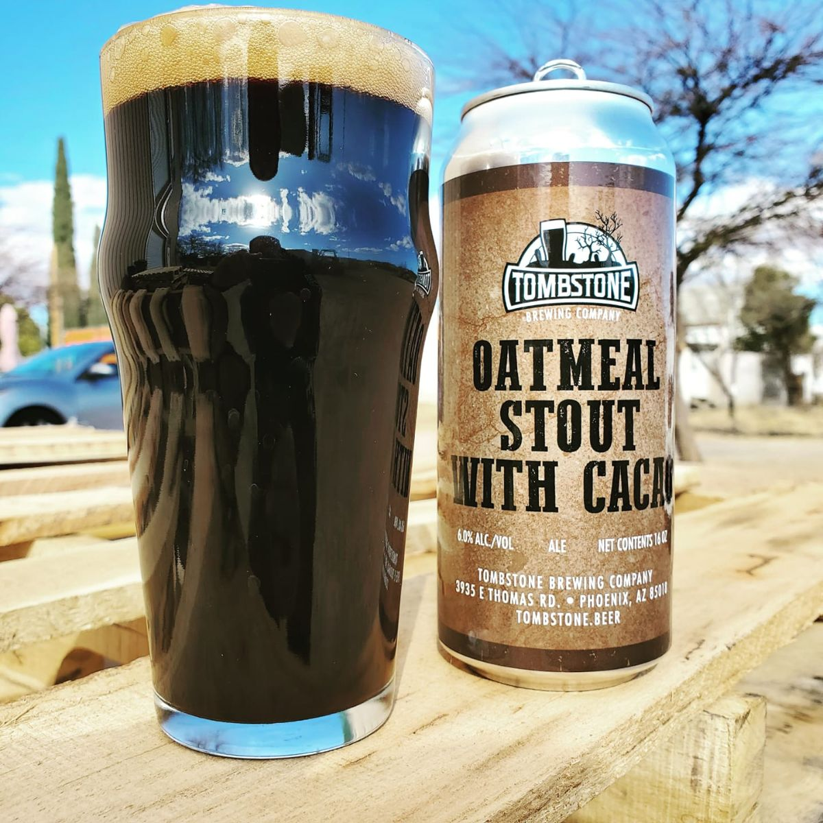 tombstone beer oatmeal stout with cacao in a pint glass and can outside