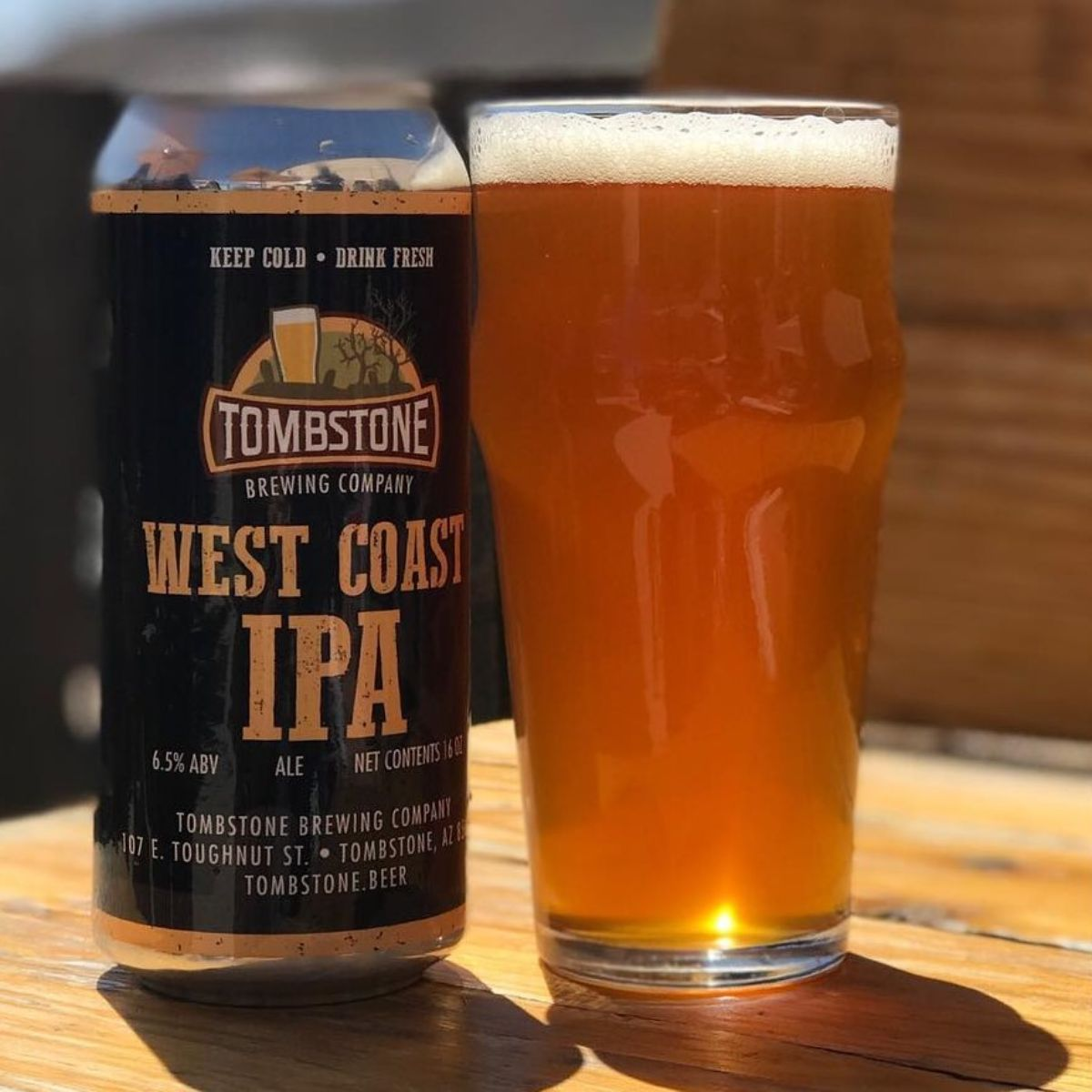 tombstone brewery west coast ipa in a can and pint